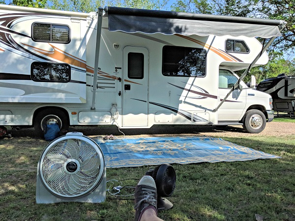 fan at a campsite to banish insects. camping tips