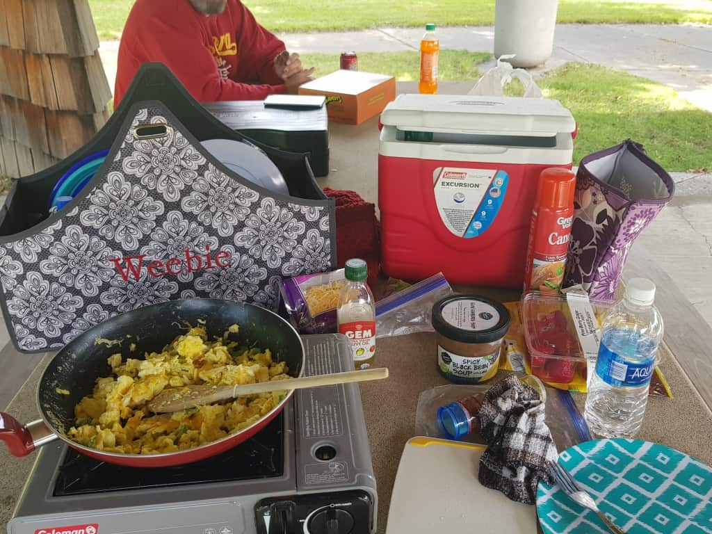 Cooking at a rest stop while van camping