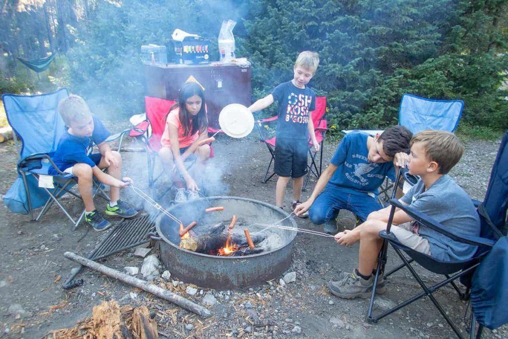 Grand-Teton-National-Park-camping-camp-fire-kids-hot-dogs-Carltonauts-Travel-Tips